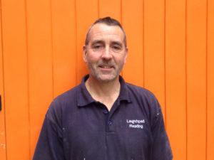 Paul standing in front of orange door