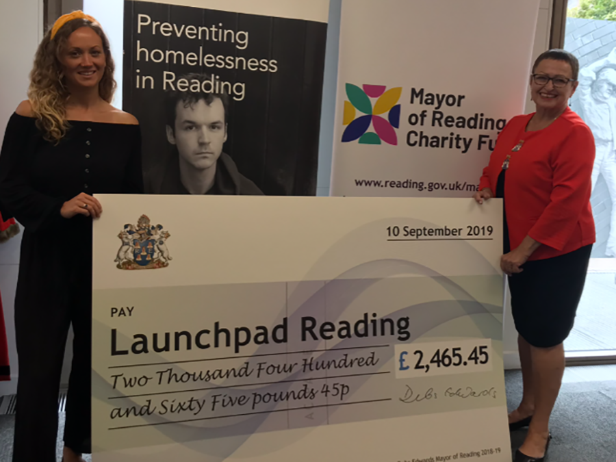 launchpad women holding cheque
