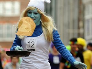 girl in smurf outfit flipping pancake